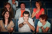 picture of bleachers  - Group of seven audience watching movie laugh in theater - JPG