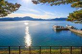 Passenger Ships With Sparkling Sunshine In Lake Tazawa - Senboku, Akita, Japan poster