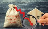 Bag With The Money And The Word Mortgage Interest Rates And Arrow To Down And House. Low Interest In poster
