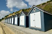 Beach Huts Along The Promenade On The Seafront At Bournemouth In Dorset poster