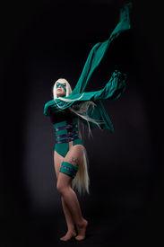 stock photo of banshee  - blond girl posing in green fury cosplay costume anime character - JPG