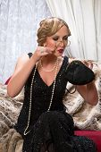 Lady in vintage 20s style with lorgnette or pince-nez