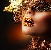 Luxury Golden Makeup. Beautiful Professional Holiday Make-up. Sexy Gold Lips.Fashion Art Portrait.Jewelry. Jewellery. Jewelery