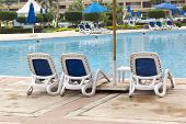 foto of snowbird  - Lounge chairs on a pool inside a hotel - JPG