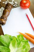 Blank Paper And Fresh Vegetables