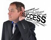 Business Man Listening To Success Help
