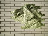 stock photo of bank vault  - Brick wall background with large hole showing detail from the US Hundred dollar bill  - JPG