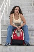 Young Latina Student With Backpack On Stairs
