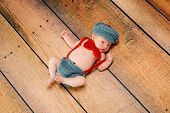 stock photo of newsboy  - 11 day old newborn baby boy wearing a vintage inspired blue - JPG