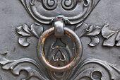 Closeup Of Metal Door With Metal Door Handle.