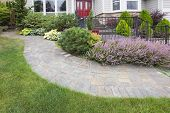 pic of red siding  - Front Yard Garden Curve Brick Paver Path with Green Grass Lawn Flowering Plants Trees and Shrubs - JPG