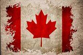 Canada Flag On Old Vintage Paper Background Concept