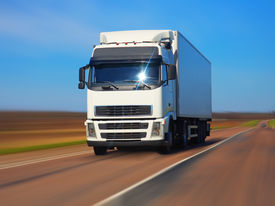pic of moving van  - Freight truck on the road with motion blur effect - JPG