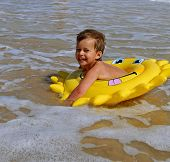 stock photo of floaties  - Fun in the sea - JPG