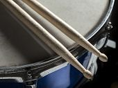 pic of drum-kit  - Drumsticks resting on the snare drum - JPG