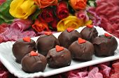 image of red velvet cake  - Red Velvet Cake Pops with roses in the background - JPG