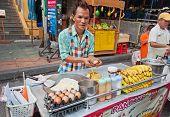 Man Cooks Thai Banana Pancake On The Street