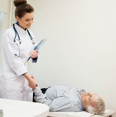 Senior man lying at daybed at doctor's office