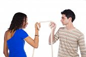 stock photo of rope pulling  - Man and woman pulling a rope competing  - JPG