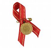 Turkish traditional gold coin with red ribbon