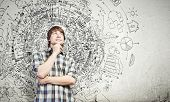 stock photo of thoughtfulness  - Young thoughtful handsome man in casual thinking over the ideas - JPG
