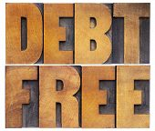 debt free - financial concept - isolated text in vintage letterpress wood type