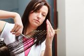 picture of hair comb  - Hairstylist with comb and scissors cutting hair of female client - JPG