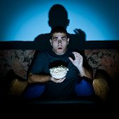 Man Watching Horror Movie