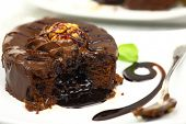 foto of chocolate spoon  - Chocolate dessert with melted chocolate running from inside - JPG