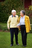 stock photo of old couple  - Elder couple walking together at the park - JPG