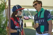 TSELEEVO, MOSCOW REGION, RUSSIA - JULY 26, 2014: Jacqueline Hooper and Alexander Rose talk before the match during the British Polo Day. Tseleevo Golf & Polo Club hosts the event for the second time