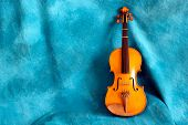 Full Violin Against Blue Backdrop