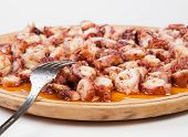 Pulpo A Feira In A Wooden Plate With Fork