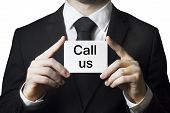 Businessman Holding Sign Call Us