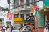 KATHMANDU, NEPAL - AUGUST 3, 2014: Indian Prime Minister Narendra Modi portrait and Nepalese and Indian flags in the street of Kathmandu for his 2-day official Nepal visit.