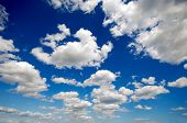 Cloudscape with cumulus clouds and blue sky