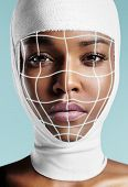 Black Woman With Bandaged Head And Glowing Surgery Lines