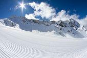 perfectly groomed empty ski piste, ski resort