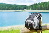 Traveler backpack infront of lake view