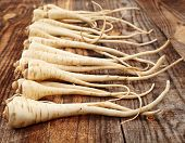 picture of parsnips  - Closeup of a bunch of parsnip on a wooden board