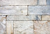 Ancient wall of marble blocks