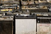 pic of junk-yard  - A pallet holds several batteries awaiting recycling at a metal recycling scrap yard - JPG
