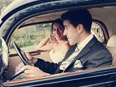 Bride And Groom Inside A Classic Car, Vintage Tone