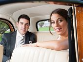 Bride And Groom Inside A Car