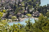 stock photo of annecy  - View upon village of Talloires along annecy lake in Savoy France - JPG