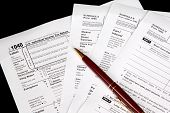 Tax Forms On Black Background