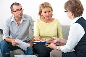 foto of family planning  - Mature couple getting financial advice from consultant at home