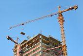 Construction site. High-rise Building Under Construction. Housing crane operation.