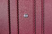 Silver peephole in luxury red iron door