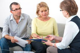 foto of maturity  - Mature couple getting financial advice from consultant at home  - JPG